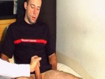 A real fireman gets wanked his big dick by a gy in spite of him !